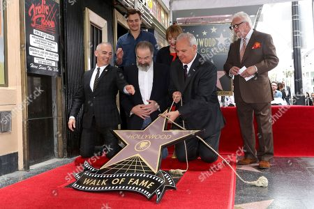 Max Mutchnick, Rupert Friend, Mandy Patinkin, Patti LuPone, Jeff Zarrinnam, Vin Di Bona. Max Mutchnick, from left, Rupert Friend, Mandy Patinkin, Patti LuPone, Jeff Zarrinnam and Vin Di Bona appear at a ceremony unveiling Patinkin's star on the Hollywood Walk of Fame, in Los Angeles