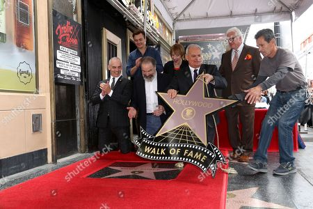 Max Mutchnick, Rupert Friend, Mandy Patinkin, Patti LuPone, Jeff Zarrinnam, Vin Di Bona. Max Mutchnick, from left, Rupert Friend, Mandy Patinkin, Patti LuPone, Jeff Zarrinnam and Vin Di Bona unveil the star at the ceremony honoring Mandy Patinkin with a star at the Hollywood Walk of Fame, in Los Angeles