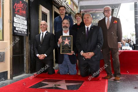 Max Mutchnick, Rupert Friend, Mandy Patinkin, Patti LuPone, Jeff Zarrinnam, Vin Di Bona. Max Mutchnick, from left, Rupert Friend, Mandy Patinkin, Patti LuPone, Jeff Zarrinnam and Vin Di Bona pose for a photo after unveiling the star at the ceremony honoring Mandy Patinkin with a star at the Hollywood Walk of Fame, in Los Angeles