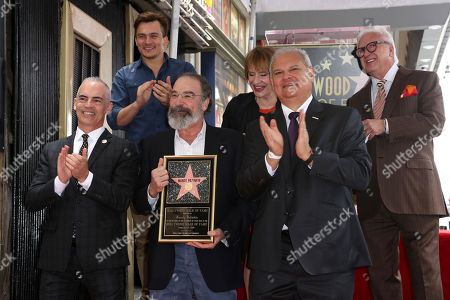Max Mutchnick, Rupert Friend, Mandy Patinkin, Patti LuPone, Jeff Zarrinnam, Vin Di Bona. Max Mutchnick, from left, Rupert Friend, Mandy Patinkin, Patti LuPone, Jeff Zarrinnam and Vin Di Bona celebrate after unveiling the star at the ceremony honoring Mandy Patinkin with a star at the Hollywood Walk of Fame, in Los Angeles