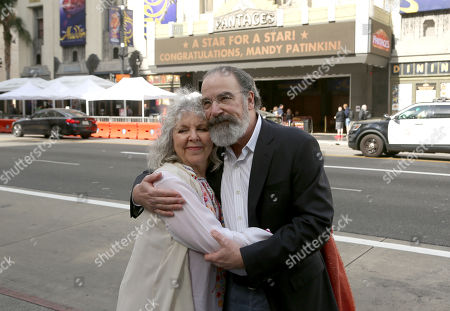 Mandy Patinkin, Kathryn Grody. Mandy Patinkin, right, and his wife Kathryn Grody pose for a photo in front of the Pantages theatre where a congratulations message is displayed after him being honored with a star at the Hollywood Walk of Fame, in Los Angeles