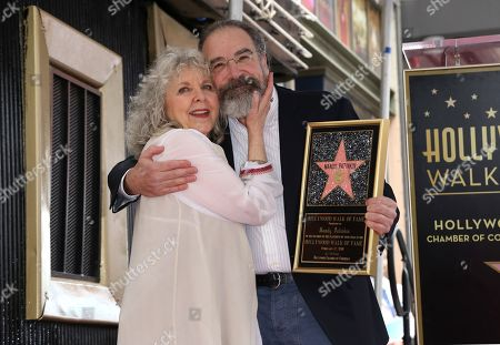 Mandy Patinkin, Kathryn Grody. Mandy Patinkin, right, and his wife Kathryn Grody pose for a photo after him being honored with a star at the Hollywood Walk of Fame, in Los Angeles