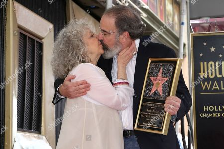 Mandy Patinkin, Kathryn Grody. Mandy Patinkin, right, and his wife Kathryn Grody kiss as a sign of celebration after him being honored with a star at the Hollywood Walk of Fame, in Los Angeles
