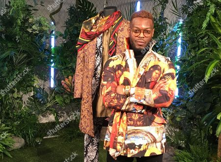 """Stock Image of Wale Oyejide, founder of the brand Ikire Jones, stands with his menswear design for a fashion collection inspired by the superhero film """"Black Panther,"""", in New York. The designs will be auctioned to benefit the charity Save the Children"""