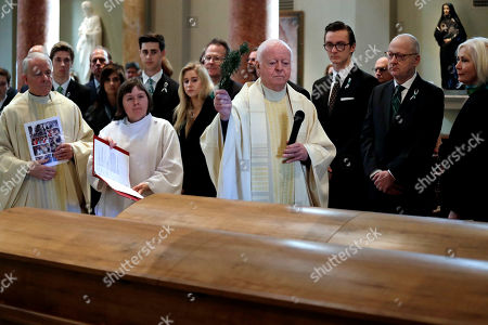 John Spellman, Oliver Duggan. As family members look, the Rev. Oliver Duggan sprinkles holy water on the caskets former Gov. John Spellman and that of his wife, Lois Spellman, before a joint funeral Mass for them at St. James Cathedral, in Seattle. John Spellman, the last Republican to serve as Washington's chief executive, died last month at the age of 91. Lois Spellman, his wife of 63 years, died days later