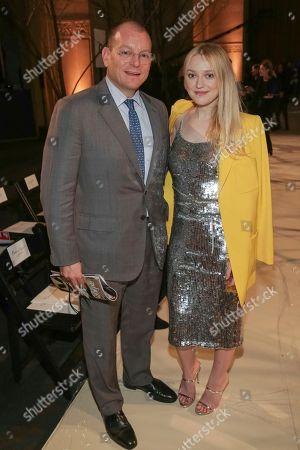 Alex Bolen, Dakota Fanning. Oscar De La Renta CEO Alex Bolen, left, and actress Dakota Fanning attend the Oscar De La Renta 2018 Fall/Winter Runway Show during New York Fashion Week at the Cunard Building on in New York