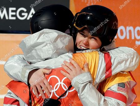 Arielle Gold, right, of the United States,embraces Kelly Clark, of the United States, during the women's halfpipe finals at Phoenix Snow Park at the 2018 Winter Olympics in Pyeongchang, South Korea