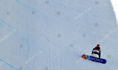 Emily Arthur, of Australia, sits upright after crashing during the women's halfpipe finals at Phoenix Snow Park at the 2018 Winter Olympics in Pyeongchang, South Korea