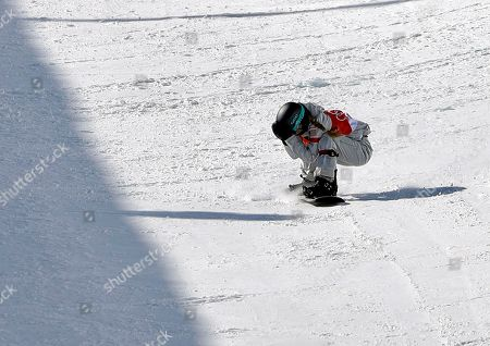 Maddie Mastro, of the United States, reacts after crashing during the women's halfpipe finals at Phoenix Snow Park at the 2018 Winter Olympics in Pyeongchang, South Korea