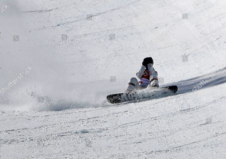 Maddie Mastro, of the United States, crashes during the women's halfpipe finals at Phoenix Snow Park at the 2018 Winter Olympics in Pyeongchang, South Korea