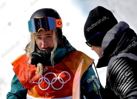 Emily Arthur, of Australia, is helped off the course after crashing during the women's halfpipe finals at Phoenix Snow Park at the 2018 Winter Olympics in Pyeongchang, South Korea