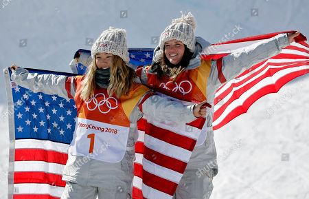 Gold winner Chloe Kim, of the United States, (1) and bronze winner Arielle Gold, of the United States, celebrate after the women's halfpipe finals at Phoenix Snow Park at the 2018 Winter Olympics in Pyeongchang, South Korea