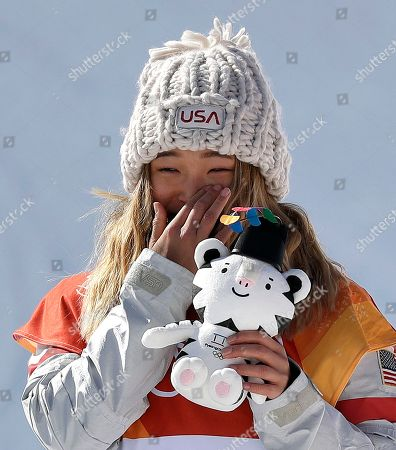 Chloe Kim, of the United States, wipes away a tear after winning gold in the women's halfpipe finals at Phoenix Snow Park at the 2018 Winter Olympics in Pyeongchang, South Korea