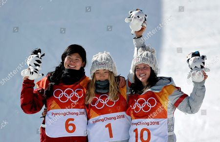 Gold winner Chloe Kim, of the United States, (1), silver winner Liu Jiayu, of China, (6) and bronze winner Arielle Gold, of the United States, (10), celebrate after the women's halfpipe finals at Phoenix Snow Park at the 2018 Winter Olympics in Pyeongchang, South Korea