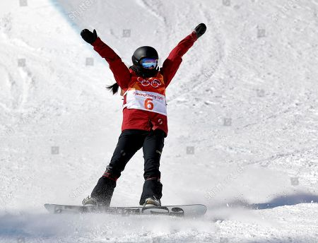 Liu Jiayu, of China, cheers as she finishes her run during the women's halfpipe finals at Phoenix Snow Park at the 2018 Winter Olympics in Pyeongchang, South Korea