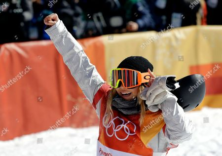 Chloe Kim, of the United States, reacts to her run during the women's halfpipe finals at Phoenix Snow Park at the 2018 Winter Olympics in Pyeongchang, South Korea