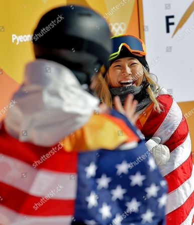 Gold winner Chloe Kim, of the United States, and bronze winner Arielle Gold, of the United States, celebrate after the women's halfpipe finals at Phoenix Snow Park at the 2018 Winter Olympics in Pyeongchang, South Korea