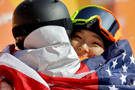 Gold winner Chloe Kim, of the United States, and bronze winner Arielle Gold, of the United States, embrace after the women's halfpipe finals at Phoenix Snow Park at the 2018 Winter Olympics in Pyeongchang, South Korea