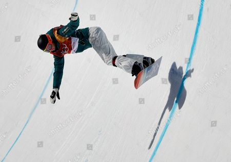 Emily Arthur, of Australia, runs the course during the women's halfpipe finals at Phoenix Snow Park at the 2018 Winter Olympics in Pyeongchang, South Korea