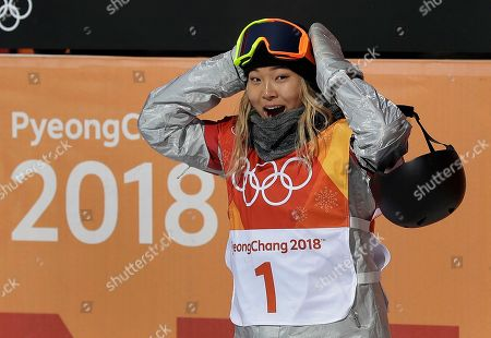 Chloe Kim, of the United States, reacts to her score during the women's halfpipe finals at Phoenix Snow Park at the 2018 Winter Olympics in Pyeongchang, South Korea