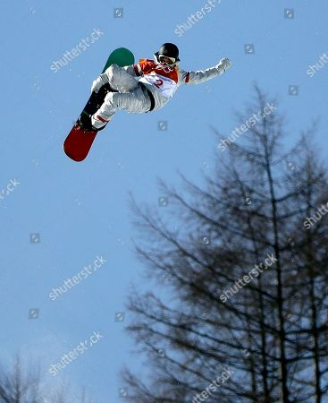 Kelly Clark, of the United States, jumps during the women's halfpipe finals at Phoenix Snow Park at the 2018 Winter Olympics in Pyeongchang, South Korea