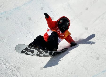 Cai Xuetong, of China, crashes during the women's halfpipe finals at Phoenix Snow Park at the 2018 Winter Olympics in Pyeongchang, South Korea