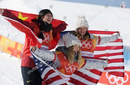 Gold medalist in first place, Chloe Kim of the US (C) pokes out her tongue with Liu Jiayu of China (L) who came second for silver, and Arielle Gold of the USA (R) who came third for bronze at the venue ceremony for the winners of the Women's Snowboard Halfpipe final at the Bokwang Phoenix Park during the PyeongChang 2018 Olympic Games, South Korea, 13 February 2018.