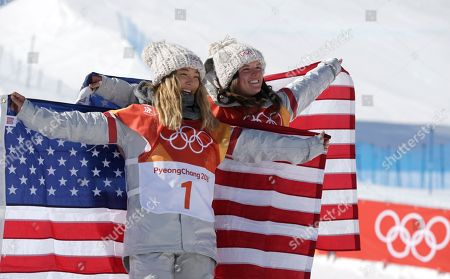 Gold medalist in first place, Chloe Kim of the US ((L) with Arielle Gold of the USA (R) who came third for bronze with American flags at the venue ceremony for the winners of the Women's Snowboard Halfpipe final at the Bokwang Phoenix Park during the PyeongChang 2018 Olympic Games, South Korea, 13 February 2018.