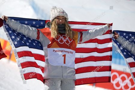 Gold medalist in first place, Chloe Kim of the US with American flag at the venue ceremony for the winners of the Women's Snowboard Halfpipe final at the Bokwang Phoenix Park during the PyeongChang 2018 Olympic Games, South Korea, 13 February 2018.