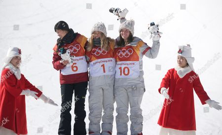 Gold medalist in first place, Chloe Kim of the US (C) with Liu Jiayu of China (L) who came second for silver, and Arielle Gold of the USA (R) who came third for bronze on the podium at the venue ceremony for the winners of the Women's Snowboard Halfpipe final at the Bokwang Phoenix Park during the PyeongChang 2018 Olympic Games, South Korea, 13 February 2018.