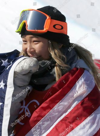 Gold medalist in first place, Chloe Kim of the US walks wrapped in an American flag at the venue ceremony for the winners of the Women's Snowboard Halfpipe final at the Bokwang Phoenix Park during the PyeongChang 2018 Olympic Games, South Korea, 13 February 2018.