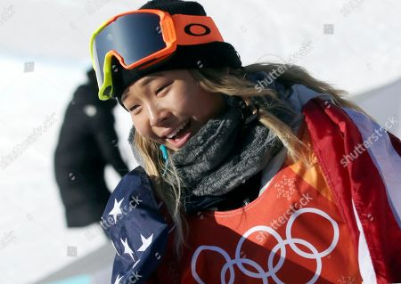Gold medalist in first place, Chloe Kim of the US reacts after winning the Women's Snowboard Halfpipe final at the Bokwang Phoenix Park during the PyeongChang 2018 Olympic Games, South Korea, 13 February 2018.