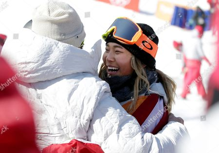 Gold medalist in first place, Chloe Kim of the US is hugged by her team at the Women's Snowboard Halfpipe final at the Bokwang Phoenix Park during the PyeongChang 2018 Olympic Games, South Korea, 13 February 2018.
