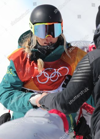 Emily Arthur of Australia is assisted after crashing during competition in the Women's Snowboard Halfpipe final at the Bokwang Phoenix Park during the PyeongChang 2018 Olympic Games, South Korea, 13 February 2018.