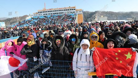 Chinese and Japanese spectators cheer for snowboarders from their respective countries during the Women's Snowboard Halfpipe final competition at the Bokwang Phoenix Park during the PyeongChang 2018 Olympic Games, South Korea, 13 February 2018.
