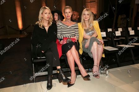 Stock Photo of Princess Maria-Olympia of Greece and Denmark, Nicky Hilton Rothschild, Dakota Fanning. Princess Maria-Olympia of Greece and Denmark, from left, businesswoman Nicky Hilton Rothschild and actress Dakota Fanning attend the Oscar De La Renta 2018 Fall/Winter Runway Show during New York Fashion Week at the Cunard Building on in New York