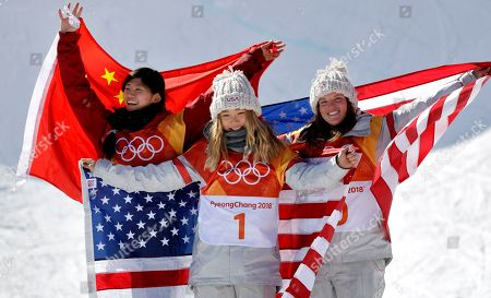 Gold winner Chloe Kim, of the United States, front, silver winner Liu Jiayu, of China, left, and bronze winner Arielle Gold, of the United States, celebrate after the women's halfpipe finals at Phoenix Snow Park at the 2018 Winter Olympics in Pyeongchang, South Korea