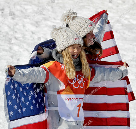 Gold medal winner Chloe Kim, of the United States, (1) and bronze winner Arielle Gold, of the United States, celebrate after the women's halfpipe finals at Phoenix Snow Park at the 2018 Winter Olympics in Pyeongchang, South Korea
