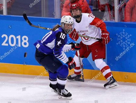 Meghan Duggan (10), of the United States, and Russian athlete Yekaterina Nikolayeva (76) chase the puck during the first period of the preliminary round of the women's hockey game at the 2018 Winter Olympics in Gangneung, South Korea