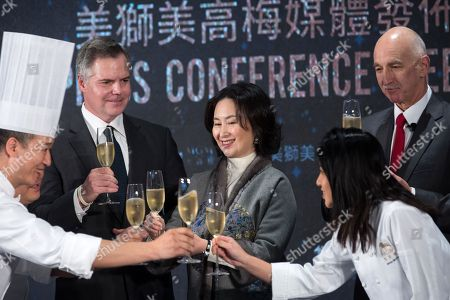 MGM China Holdings Limited Chief Executive Officer Grant R. Bowie, (R), MGM China Holdings Limited co-chairperson and Executive Director Pansy Ho, (C), and MGM Resorts International Chairman and Chief Executive Officer James J. Murren, (L), make a toast before the opening of the casino in Macau, China, 13 February 2018. The US3.4 billion, Euros2.75 billion, integrated resort is the latest addition to Macau, the only territory of China where gambling is legal.