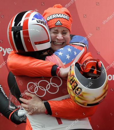 Dajana Eitberger of Germany celebrates her silver medal win the finish area with Erin Hamlin of the United States after the women's luge final at the 2018 Winter Olympics in Pyeongchang, South Korea