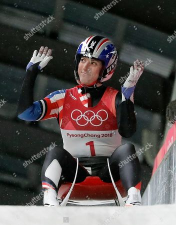 Erin Hamlin of the United States brakes in the finish area after the women's luge final at the 2018 Winter Olympics in Pyeongchang, South Korea