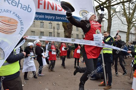 Tom Newton Dunn. The annual Rehab Parliamentary Pancake Race takes place in Victoria Tower Gardens next to Parliament, with members of the press and Parliamentarians racing for the Rehab charity.