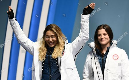 Gold medalist Chloe Kim (C) of the US enters the stage ahead of bronze winner Arielle Gold of the USA during the medal ceremony for the women's Snowboard Halfpipe event during the PyeongChang 2018 Olympic Games, South Korea, 13 February 2018.