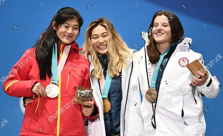 Gold medalist Chloe Kim (C) of the US is flanked by silver medalist Liu Jiayu of China (L) and bronze winner Arielle Gold of the USA during the medal ceremony for the women's Snowboard Halfpipe event during the PyeongChang 2018 Olympic Games, South Korea, 13 February 2018.
