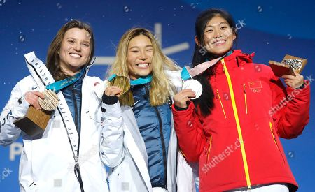 Gold medalist Chloe Kim (C) of the US is flanked by silver medalist Liu Jiayu of China (R) and bronze winner Arielle Gold of the USA during the medal ceremony for the women's Snowboard Halfpipe event during the PyeongChang 2018 Olympic Games, South Korea, 13 February 2018.