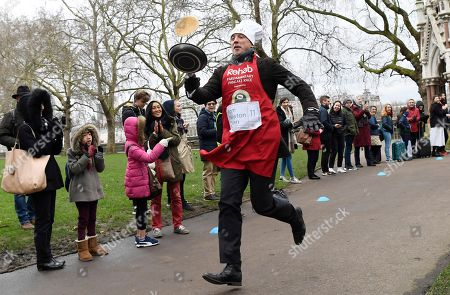 Journalist Tom Newton Dunn takes part in the annual Parliamentary Pancake Race in Westminster in London, Britain,13 February 2018.  The race is held on Shrove Tuesday between members of the Houses of Lords and Commons and members of media to raise money for charity.
