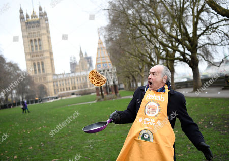 Television journalist Alastair Stewart poses before the annual Parliamentary Pancake Race in Westminster in London, Britain,13 February 2018.  The race is held on Shrove Tuesday between members of the Houses of Lords and Commons and members of media to raise money for charity.