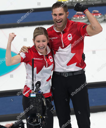 John Morris (R) celebrates with teammate Kaitlyn Lawes (L) of Canada after winning the gold medal against Switzerland during the Mixed Doubles Gold Medal Game inside the Gangneung Curling Centre at the PyeongChang Winter Olympic Games 2018, in Gangneung, South Korea, 13 February 2018.
