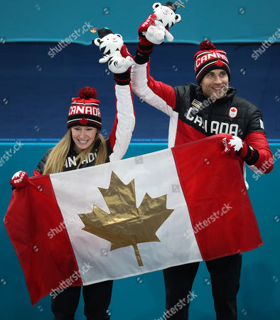 Gold medal winner John Morris (R) and teammate Kaitlyn Lawes (L) of Canada celebrate on the podium for the Mixed Doubles final at the Gangneung Curling Centre during the PyeongChang Winter Olympic Games 2018, in Gangneung, South Korea, 13 February 2018.